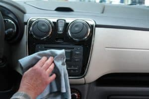 cleaning car dashboard