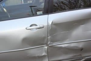 dented and scratched car door