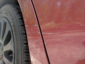 scratch on rear door of car